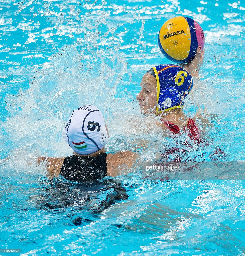 Spain's Jennifer Pareja passes the ball to a teammate while being defended by Hungary's Ildiko Toth during their semifinal match at the Water Polo...