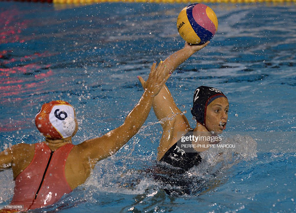 Spain's Jennifer Pareja vies with US player Lauren Silver during their women's water polo quarterfinals match at the FINA World Championships on July...