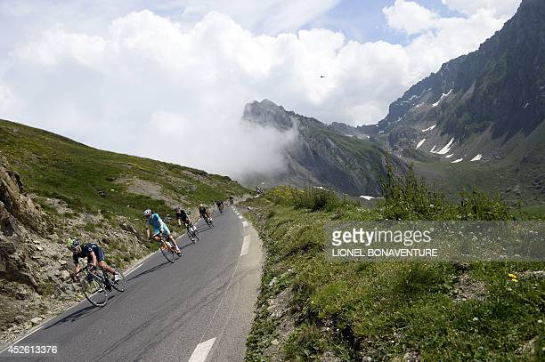 Spain's Jesus Herrada Lopez rides in the pack during the 1455 km eighteenth stage of the 101st edition of the Tour de France cycling race on July 24...