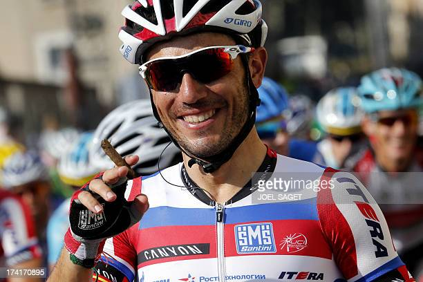 Spain's Joaquim Rodriguez Oliver celebrates his thirdplaced in the overall standings with a cigare before the start of the 1335 km twentyfirst and...