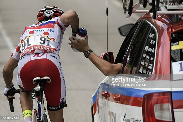 Spain's Joaquim Rodriguez wearing the best climber's polka dot jersey takes refreshments from his team car during the 1865 km eighteenth stage of the...