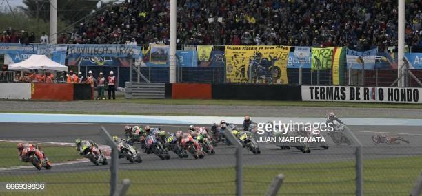 Spain's Jorge Lorenzo falls from his Ducati during the 1st lap of the MotoGP race of the Argentina Grand Prix at Termas de Rio Hondo circuit in...