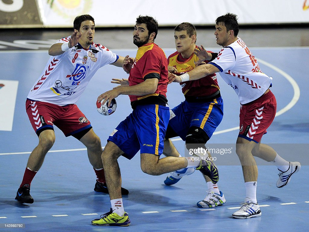 Spain's Jorge Maqueda Pena (2nd L) and Julen Aguinagalde Akizu (2nd R) vies with Serbia's Nikola Manojlovic (L) and Momir Ilic (R) during the handball pre-Olympic qualifying match between Spain and Serbia at the Sports Centre in Alicante on April 6, 2012.