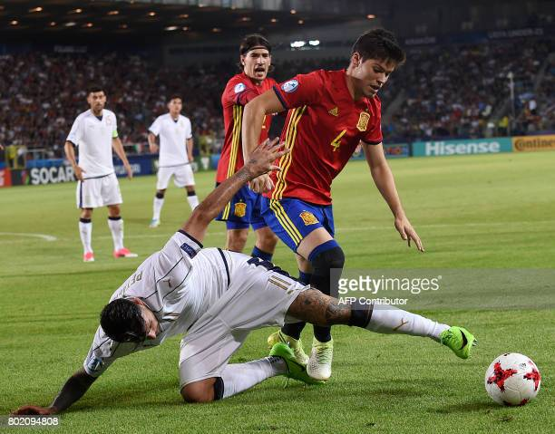 Spain's Jorge Meré and Italy's Andrea Petagna vie for the ball during the UEFA U21 European Championship football semi final match Spain v Italy in...