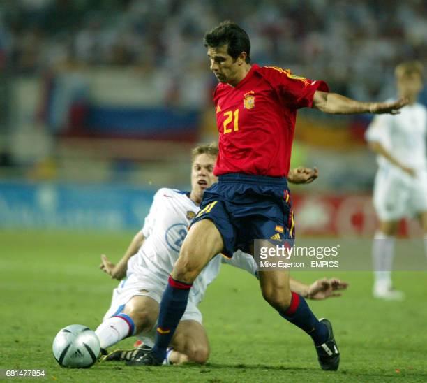 Spain's Juan Carlos Valeron and Russia's Vladimov Radimov