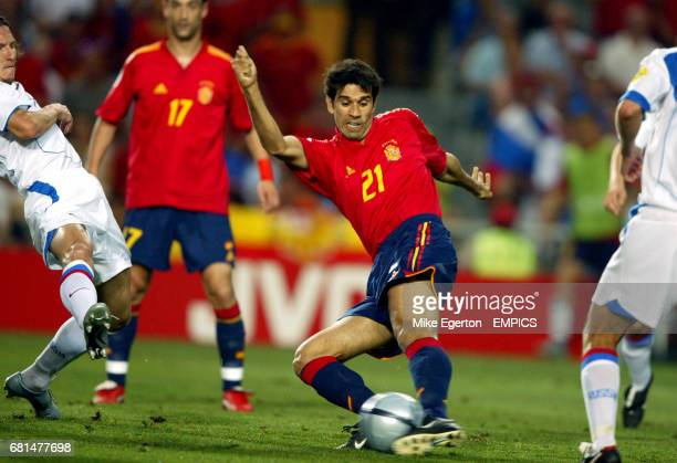Spain's Juan Carlos Valeron scores the opening goal of the game against Russia