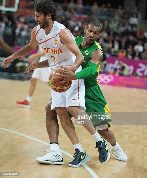 Spain's JuanCarlos Navarro is fouled from behind by Brazil's Leandrinho Barbosa during their game at the Olympic Park Basketball Arena during the...
