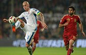 Spain's Juanfran watching Slovakia's Martin Skrtel kicking a ball during the Euro 2016 qualifing football match between Slovakia and Spain in...