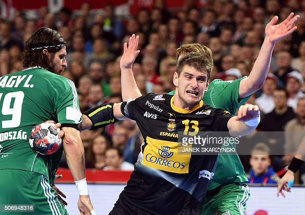 Spain's Julen Aguinagalde vies with Hungary's Laszlo Nagy during the Men's 2016 EHF European Handball Championships between Spain and Hungary in...