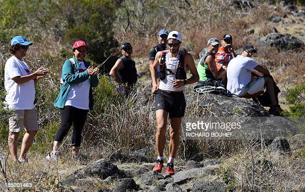 Spain's Kilian Jornet runs in the Mafate circus during the 21st Diagonale des Fous or Grand Raid a 164 km raid accross La Reunion on October 18 2013...