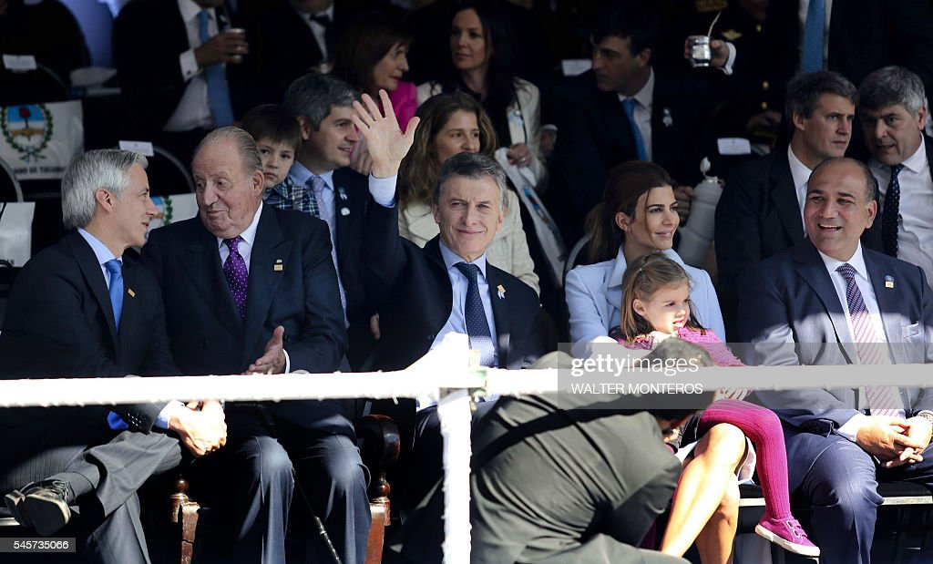 Spain's King Emeritus Juan Carlos I Argentine President Mauricio Macri and his wife Juliana Awada and their daughter attend a parade to commemorate...