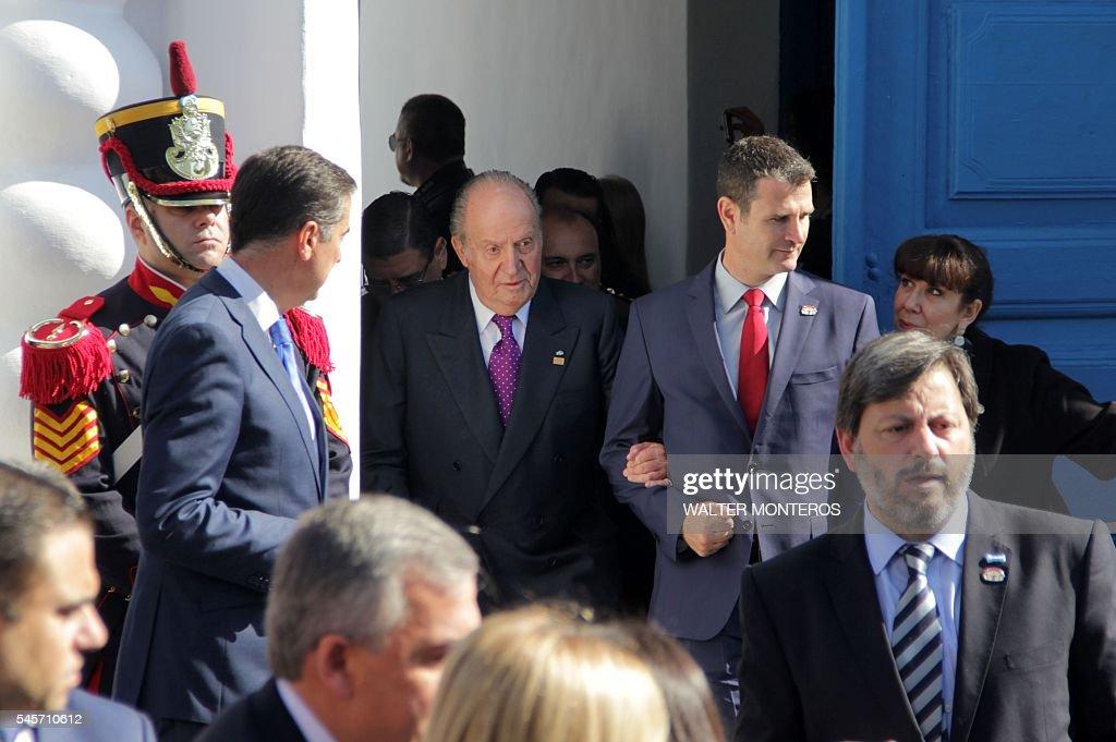 Spain's King Emeritus Juan Carlos I leaves the historic buliding 'Casa de Tucuman' during the ceremonies to commemorate the bicentenary of the...