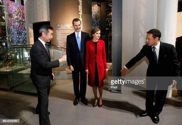 Spain's King Felipe and Queen Letizia is escorted by executive director of the museum and former astronaut Mamoru Mori and 2015 Nobel Prize in...