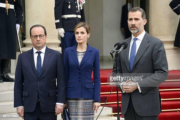 Spain's King Felipe VI addresses medias next to French president Francois Hollande and Queen Letizia of Spain as he leaves the Elysee presidential...