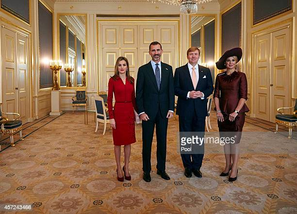Spain's King Felipe VI and his wife Queen Letizia pose for a photo with the Netherlands' King WillemAlexander and his wife Queen Maxima at the royal...
