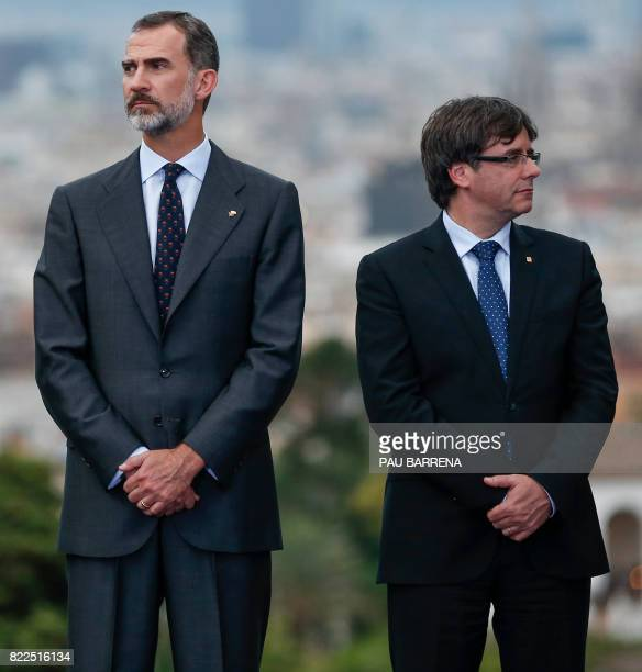 Spain's King Felipe VI and President of the Catalan regional government Carles Puigdemont pose during an event as part of the celebrations of the...
