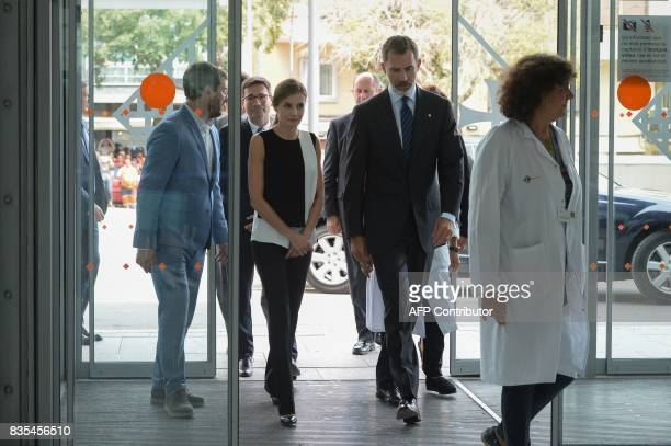 Spain's King Felipe VI and Queen Letizia arrive at the Sant Pau hospital in Barcelona to visit medical staff and victims of the Barcelona attack on...