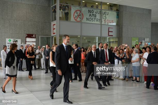 Spain's King Felipe VI and Queen Letizia leave the Sant Pau hospital in Barcelona after visiting victims of the Barcelona attack on August 19 two...