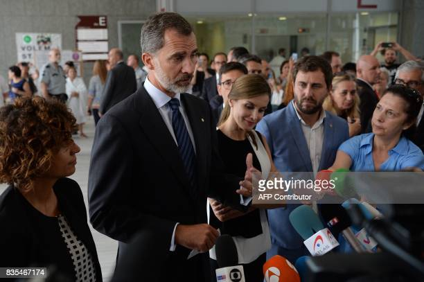 Spain's King Felipe VI and Queen Letizia talk to the press at the Sant Pau hospital in Barcelona after visiting victims of the Barcelona attack on...