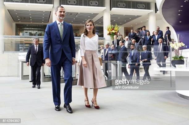 Spain's King Felipe VI and Queen Letizia walk through the lobby of the Francis Crick Institute in central London on July 14 the third and final day...