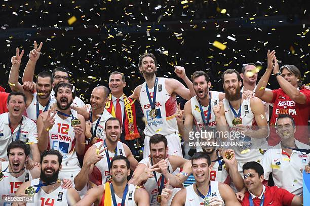 Spain's King Felipe VI and Spain's center Pau Gasol and Spain's teammates celebrate after Spain won the final basketball match between Spain and...