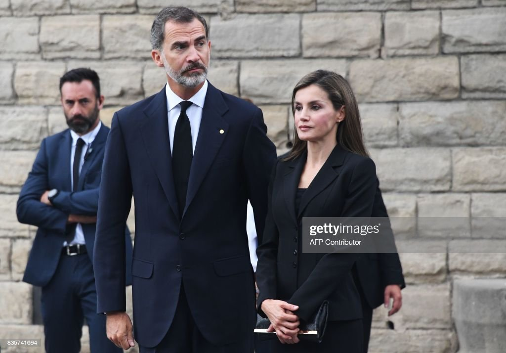 Spain's King Felipe VI and Spain's Queen Letizia arrive for a mass to commemorate victims of two devastating terror attacks in Barcelona and Cambrils, at the Sagrada Familia church in Barcelona on August 20, 2017. A grief-stricken Barcelona prepared today to commemorate victims of two devastating terror attacks at a mass in the city's Sagrada Familia church. As investigators scrambled to piece together the attacks which killed 14 people in all, Interior Minister Juan Ignacio Zoido said on August 19 the cell behind the carnage that also injured 120 and plunged the country into shock had been 'dismantled,' though local authorities took a more cautious tone. GUYOT