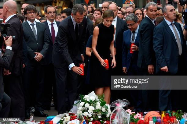 Spain's King Felipe VI and Spain's Queen Letizia display a candle for the victims of the Barcelona attack on Las Ramblas boulevard attended by...