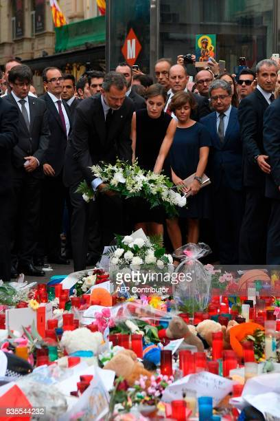 Spain's King Felipe VI and Spain's Queen Letizia lay a wreath of flowers for the victims of the Barcelona attack on Las Ramblas boulevard attended by...