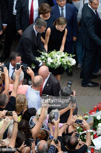 Spain's King Felipe VI and Spain's Queen Letizia lay a wreath of flowers for the victims of the Barcelona attack on Las Ramblas boulevard in...