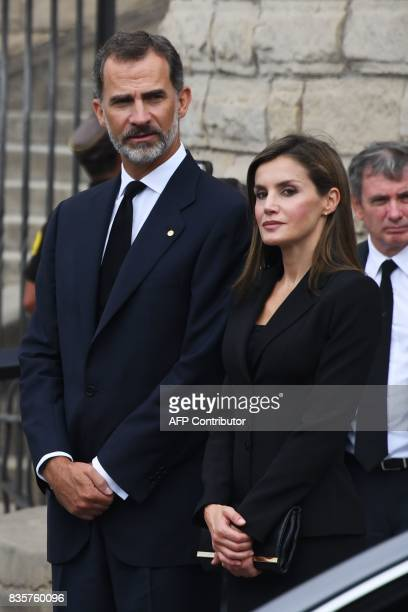 Spain's King Felipe VI and Spain's Queen Letizia leave after a mass to commemorate victims of two devastating terror attacks in Barcelona and...