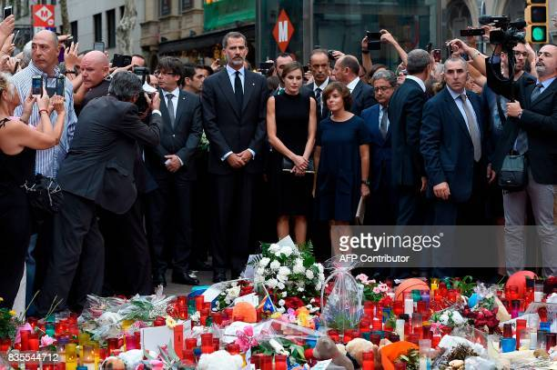 Spain's King Felipe VI and Spain's Queen Letizia pay tribute for the victims of the Barcelona attack on Las Ramblas boulevard next to President of...