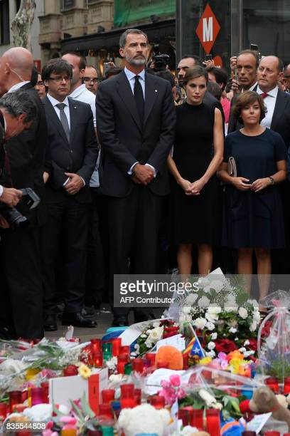 Spain's King Felipe VI and Spain's Queen Letizia pay tribute to the victims of the Barcelona attack on Las Ramblas boulevard next to President of...