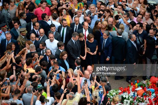 Spain's King Felipe VI and Spain's Queen Letizia pay tribute to the victims of the Barcelona attack on Las Ramblas boulevard in Barcelona on August...