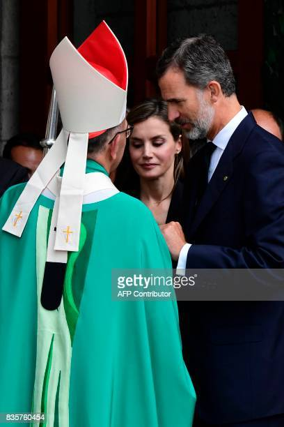 Spain's King Felipe VI and Spain's Queen Letizia speak with Archbishop of Barcelona Cardinal Joan Josep Omella as they leave after a mass to...