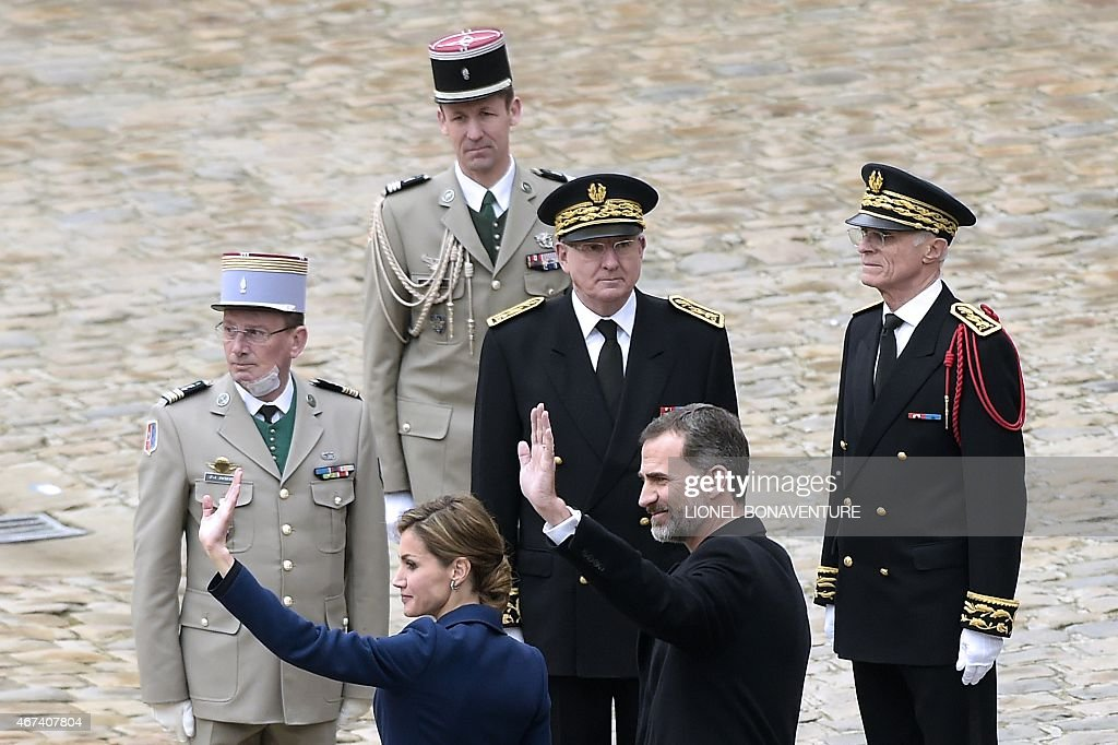 Spain's King Felipe VI (C) and Spain's Queen Letizia (L) wave next to Paris police Prefect <a gi-track='captionPersonalityLinkClicked' href=/galleries/search?phrase=Bernard+Boucault&family=editorial&specificpeople=7772884 ng-click='$event.stopPropagation()'>Bernard Boucault</a> (R) during a ceremony at the Hotel des Invalides in Paris, as part of a state visit in France on March 24, 2015. AFP PHOTO / LIONEL BONAVENTURE