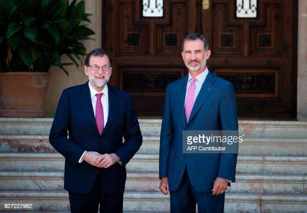 Spain's King Felipe VI and Spanish Prime Minister Mariano Rajoy pose before their meeting at the Marivent Palace in Palma de Mallorca on August 7...