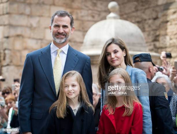 Spain's King Felipe VI his wife Queen Letizia and their daughters Princess Leonor and Sofia pose after attending the traditional Mass of Resurrection...