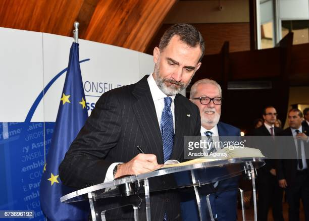 Spain's King Felipe VI signs Livre D'or as he visits the Parliamentary Assembly of the Council of Europe in Strasbourg France on April 27 2017