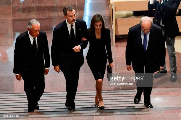Spain's King Felipe VI Spain's Queen Letizia and Portugal's President Marcelo Rebelo de Sousa arrive for a mass to commemorate victims of two...