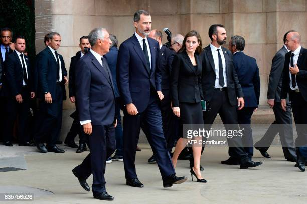 Spain's King Felipe VI Spain's Queen Letizia and Portugal's President Marcelo Rebelo de Sousa leave after a mass to commemorate victims of two...