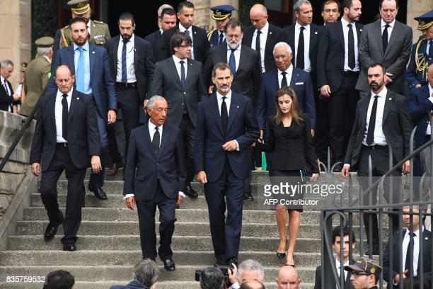 TOPSHOT Spain's King Felipe VI Spain's Queen Letizia and Portugal's President Marcelo Rebelo de Sousa President of Catalonia Carles Puigdemont...