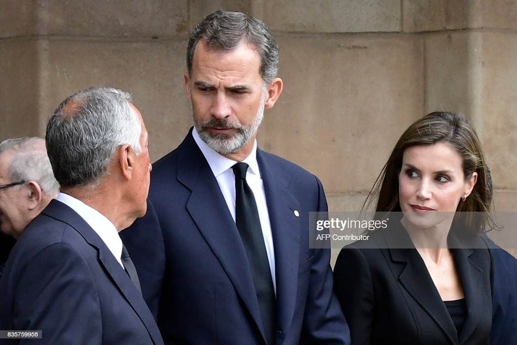 Spain's King Felipe VI (C), Spain's Queen Letizia (R) and Portugal's President Marcelo Rebelo de Sousa (L) leave after a mass to commemorate victims of two devastating terror attacks in Barcelona and Cambrils, at the Sagrada Familia church in Barcelona on August 20, 2017. A grief-stricken Barcelona prepared today to commemorate victims of two devastating terror attacks at a mass in the city's Sagrada Familia church. As investigators scrambled to piece together the attacks which killed 14 people in all, Interior Minister Juan Ignacio Zoido said on August 19 the cell behind the carnage that also injured 120 and plunged the country into shock had been 'dismantled,' though local authorities took a more cautious tone. SORIANO