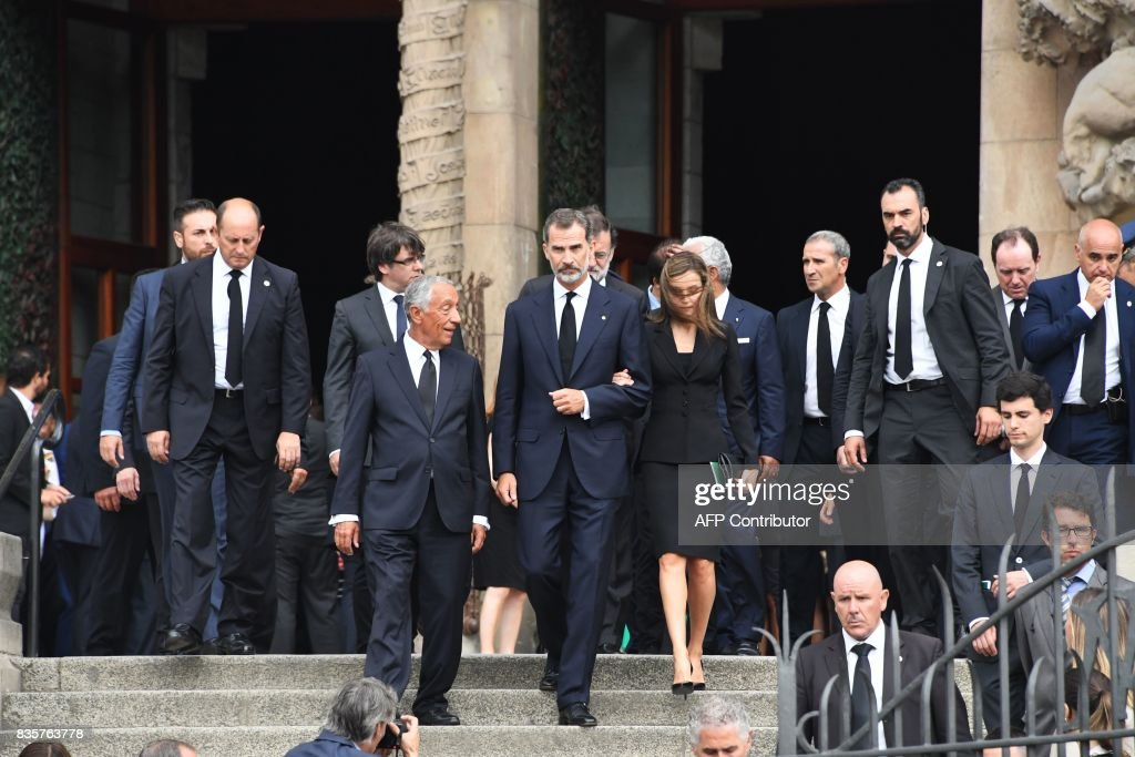 Spain's King Felipe VI (C), Spain's Queen Letizia (R) and Portugal's President Marcelo Rebelo de Sousa (L) leave after a mass to commemorate victims of two devastating terror attacks in Barcelona and Cambrils, at the Sagrada Familia church in Barcelona on August 20, 2017. A grief-stricken Barcelona commemorated victims of two devastating terror attacks at a mass in the city's Sagrada Familia church. As investigators scrambled to piece together the attacks which killed 14 people in all, Interior Minister Juan Ignacio Zoido said on August 19 the cell behind the carnage that also injured 120 and plunged the country into shock had been 'dismantled,' though local authorities took a more cautious tone. GUYOT
