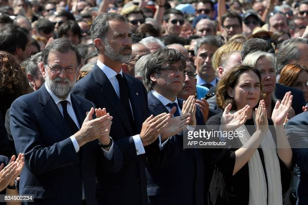 Spain's King Felipe VI Spanish Prime Minister Mariano Rajoy President of Catalonia Carles Puigdemont and Barcelona's mayor Ada Colau applaud after...