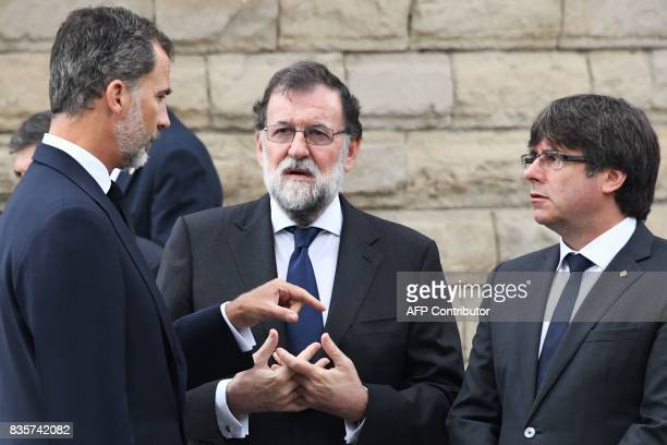 Spain's King Felipe VI Spanish Prime Minister Mariano Rajoy President of Catalonia Carles Puigdemont arrive for a mass to commemorate victims of two...