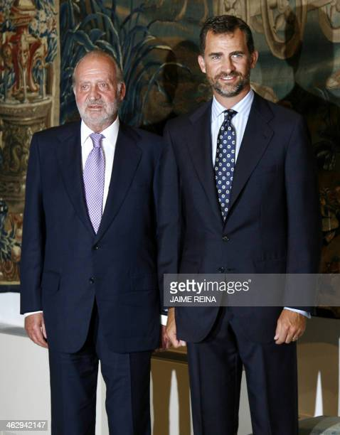 Spain's King Juan Carlos and Prince Felipe pose during a summer dinner of farewell at Almudaina Palace in Palma de Mallorca on August 28 2009 The...