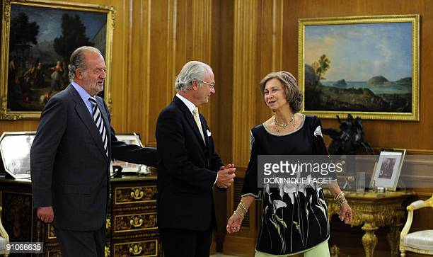 Spain's King Juan Carlos and Queen Sofia welcome Sweden's King Carl XVI Gustaf before a dinner at the Zarzuela Palace in Madrid September 23 2009...