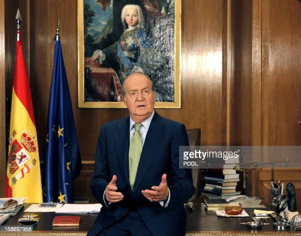 Spain's King Juan Carlos delivers his traditional televised Christmas speech at the Zarzuela Palace in Madrid on December 24 2012 King Juan Carlos...