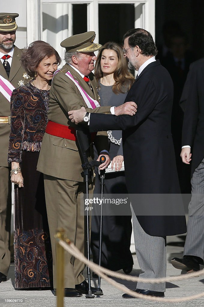 Spain's King Juan Carlos (L) greets Spanish Prime Minister Mariano Rajoy during the Pascua Militar ceremony at the Royal palace in Madrid on January 6, 2013.