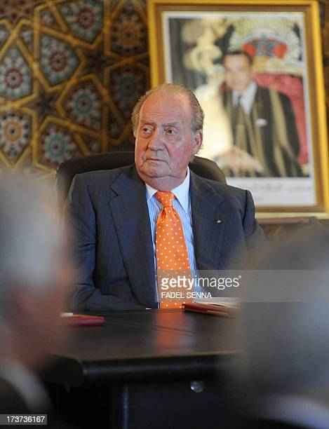 Spain's King Juan Carlos listens as he meets with Moroccan Minister of Higher education on July 172013 in the Moroccan city of Rabat The...